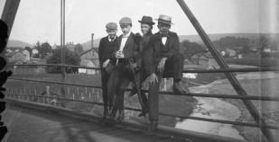 Four boys on a bridge